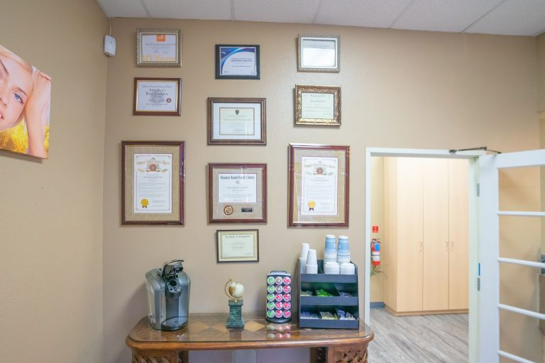 Orangecrest Dental Accolades and Coffee Table