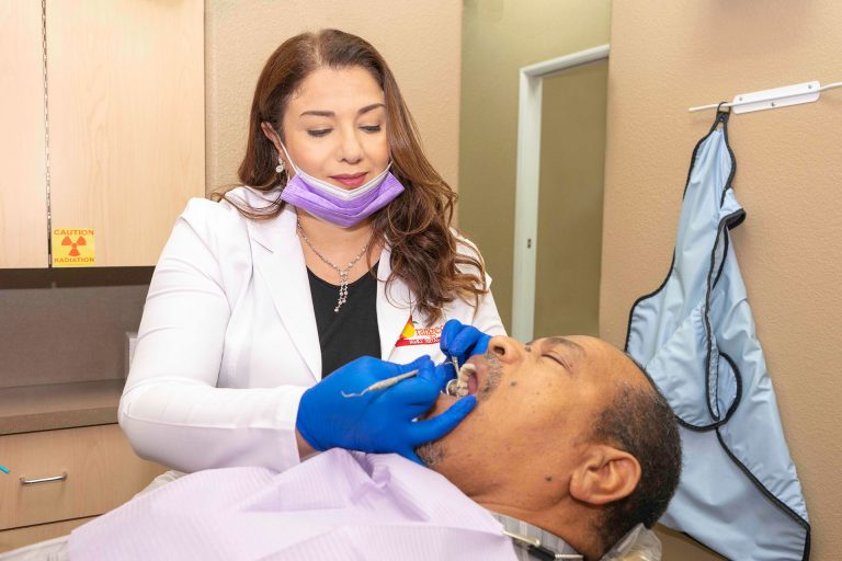 Orangecrest Dental dentist examining patient