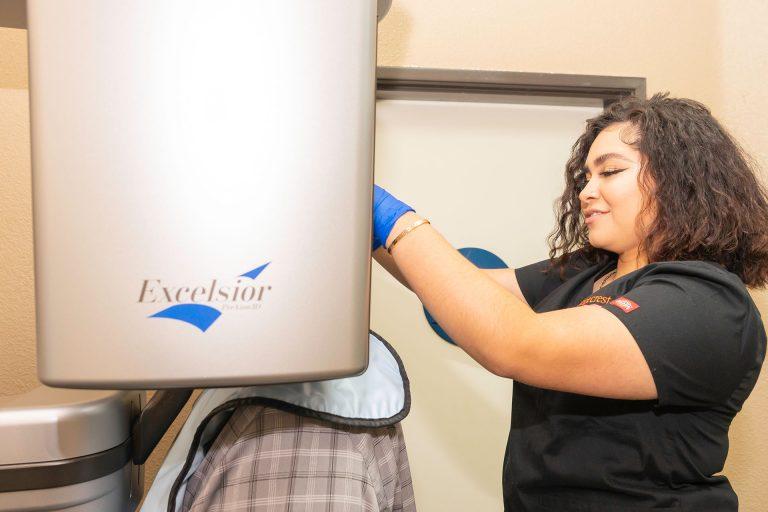Orangecrest Dental staff member examining patient
